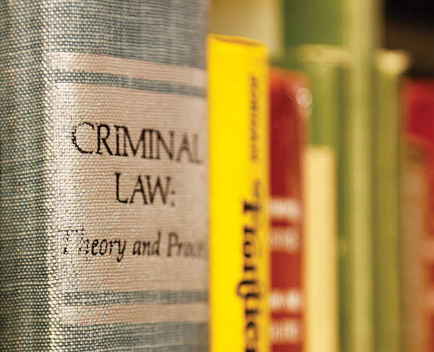 "A book spine is titled ""Criminal Law"""
