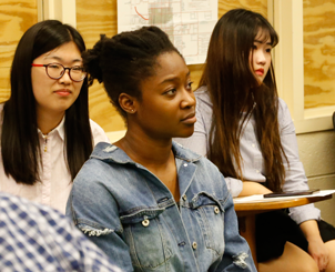 College students sitting in a classroom listening to a speaker