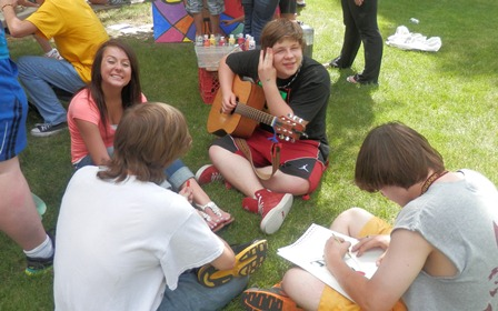 Students interact on campus green