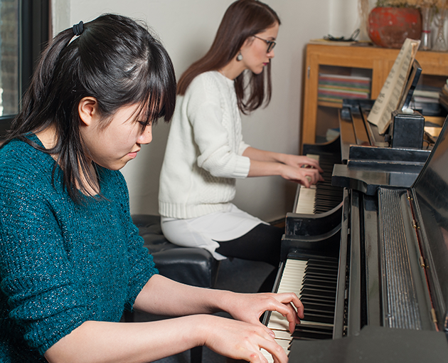 Students practicing piano skills