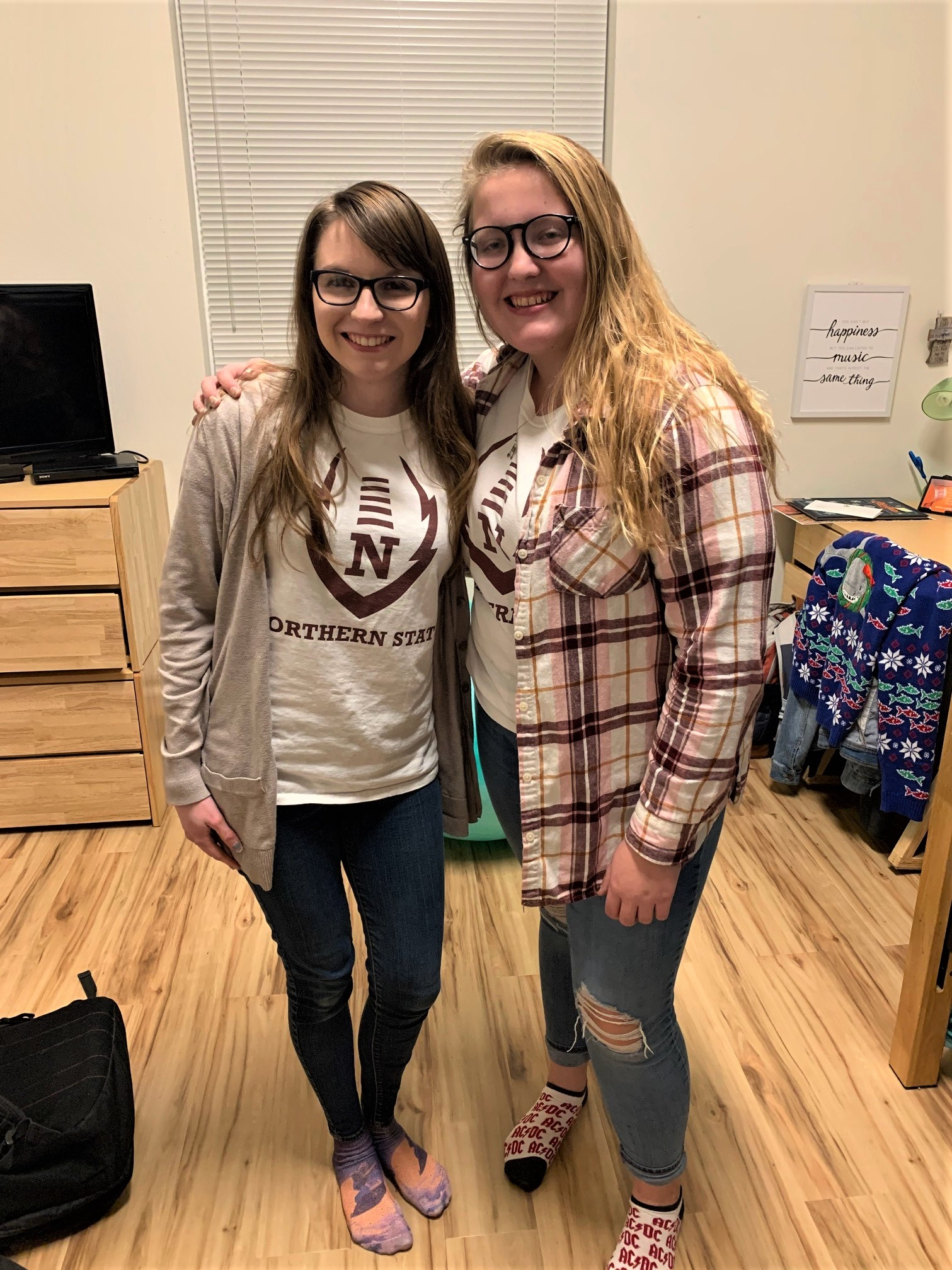 Two roommates standing together in their residence hall room
