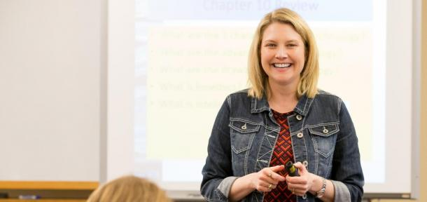 Professor smiling at students in classroom