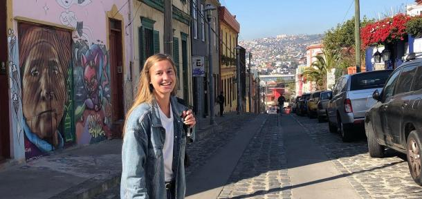 Student standing outside in a city in Chile