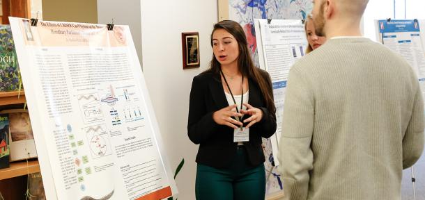 Student presenting her research poster