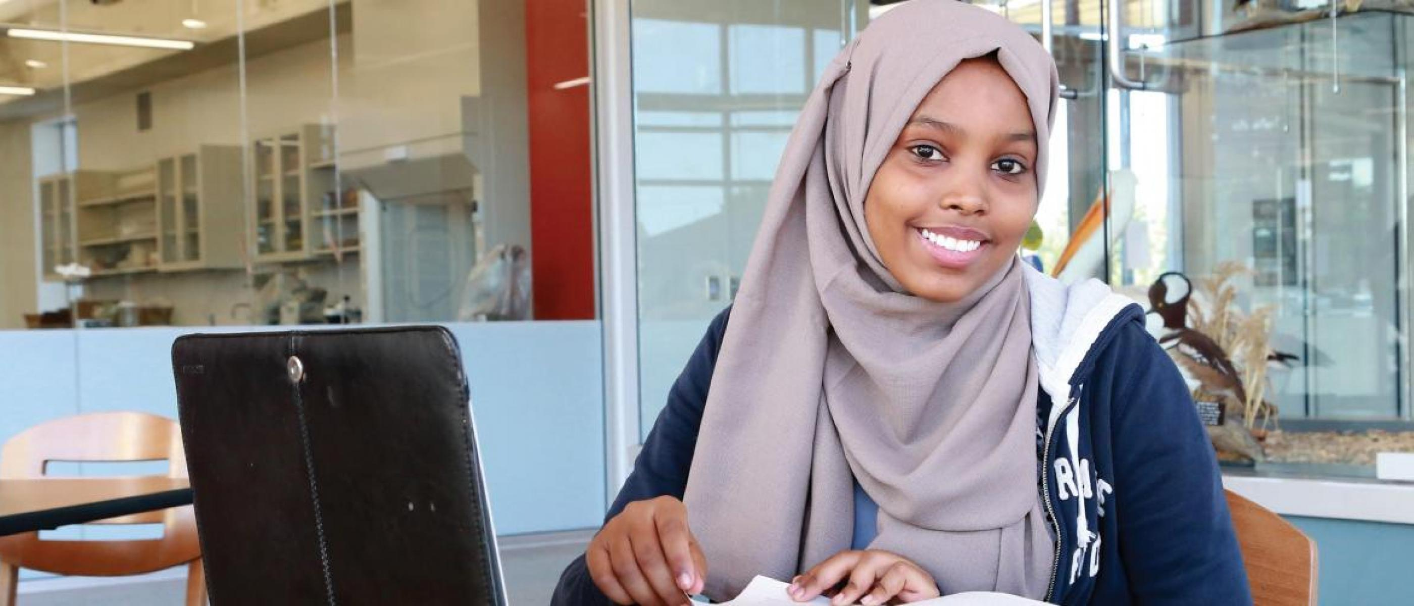 Smiling student studying in Regional Science Education Center
