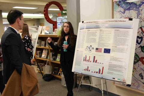 Student presenting research at forum