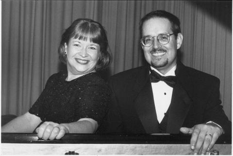 Portrait of female and male piano performers