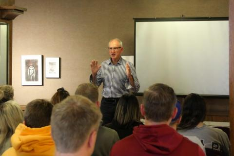 UGG Boots founder Brian Smith speaking to a room full of NSU students