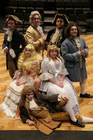THE METROMANIACS.  On the floor is Tyler Lanam, seated L and R is Christine Powers and Emily Davis.  Standing L to R is Michael Lytle, MacKinley Breummer, Levi Seefeldt and Joshua Hinkemeyer.