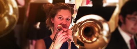 Female musician playing a horn