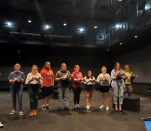 Theater students rehearsing on stage