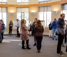 Students and faculty attending a research poster session