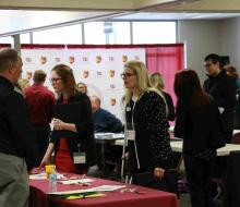 Student talking with employer at job fair