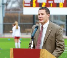 Athletic director standing at podium