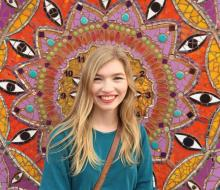 Photo of female student in front of colorful wall art