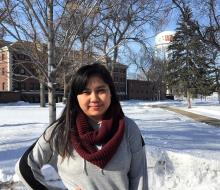 Female student standing outside on campus