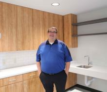 Man standing in kitchen of residence hall
