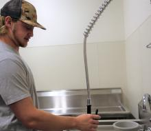 Mason Winship in NSU's game-cleaning room