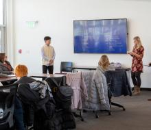 Students giving presentation in conference room