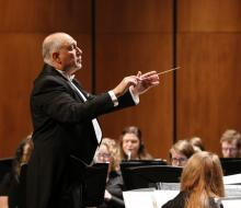 Conductor leading symphonic band