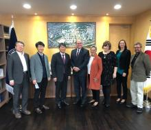NSU delegation standing with representatives of South Korean university