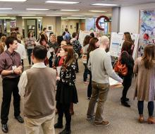 Student researchers presenting their research