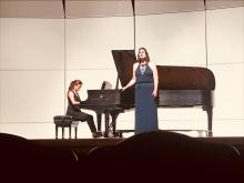 Woman playing piano while another woman sings