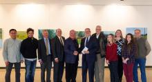 Group photo of faculty, administration and donors in JFAC Gallery