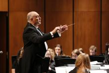 Man conducting band on stage