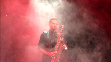 NSU alumnus playing a saxophone
