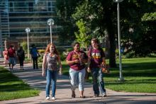 Students on Northern State University campus green.