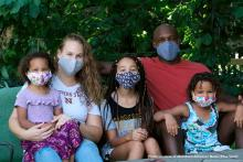 Family picture with all wearing masks