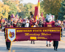 Marching Wolves marching with Thunder in parade