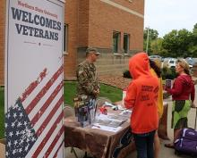 Student talking to military soldier on campus