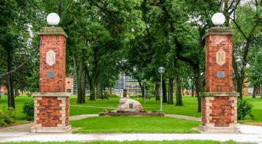 View of campus green with pillars